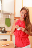 Woman with gingerbread cookies drinking tea coffee Royalty Free Stock Photo
