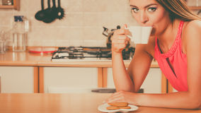 Woman with gingerbread cookies drinking tea coffee Stock Images