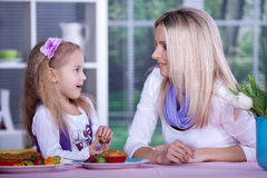 Woman with a girl Stock Images