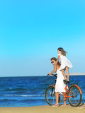 Woman and girl  on the beach Royalty Free Stock Images