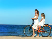 Woman and girl on the beach royalty free stock photography
