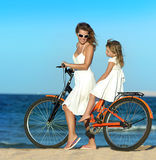 Woman and girl  on the beach Royalty Free Stock Photo