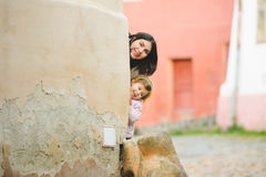 Woman and Girl Behind Corner Royalty Free Stock Image