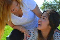 Woman Girl Bonding. Mother daughter, sisters, best friends bonding, smiling at each other Royalty Free Stock Images