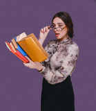 Woman girl brunette teacher in glasses books surprised opened he Royalty Free Stock Photo