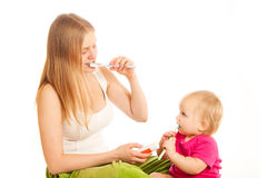 Woman and girl brushing tooth Stock Photography