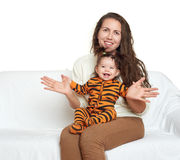 Woman with girl child portrait sitting on sofa and playing Royalty Free Stock Photography