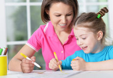 Woman and  girl with colored pencils Stock Photography