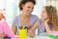 Woman and  girl with colored pencils Royalty Free Stock Images