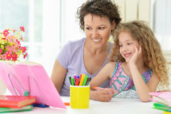 Woman and  girl with colored pencils Stock Image