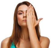 Woman girl covered her face half hand isolated Stock Images