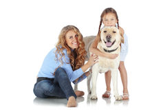 Woman and girl with a dog Stock Photos