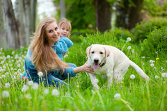 Woman with girl and dog. Beautiful woman with little girl and dog outdoors Royalty Free Stock Photography
