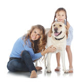 Woman and girl with a dog Stock Photo