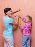 Woman and girl doing home repair Royalty Free Stock Photography