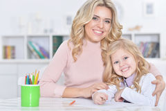 Woman and girl drawing Stock Photo