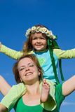 Woman and girl enjoy the spring sun Royalty Free Stock Images