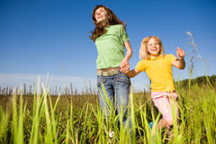 Woman and girl on field Stock Photography