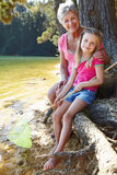 Woman and girl fishing together Stock Photography