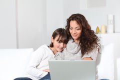Woman and girl in front of computer Royalty Free Stock Photos