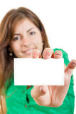Woman or girl in green shirt holding in hand bussiness card agai. Pretty smiling young woman or girl in green shirt holding in hand bussiness card against white Stock Photo