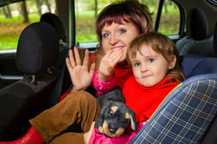 Woman and girl greeting to wave hands in car Royalty Free Stock Photo