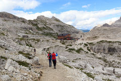 Woman and girl hiking towards alpine Hut Bullelejochhutte in Sexten Dolomites, South Tyrol Stock Images