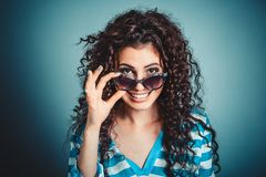 Woman girl holding sunglasses smiling royalty free stock photos