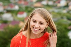 Woman or girl with long blond hair happy smile royalty free stock image