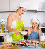 Woman and girl making pizza at home Royalty Free Stock Photo