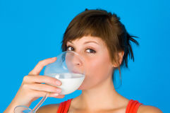 Woman, girl with milk Stock Images