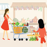 Woman girl mom shopping using cart buy vegetable at supermarket healthy ingredients Royalty Free Stock Images