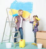 Woman and girl painting wall Stock Images