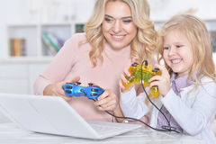 Woman and girl playing video game Stock Image