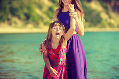 Woman and girl playing in water Royalty Free Stock Images