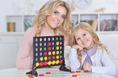 Woman and girl playing Stock Photo