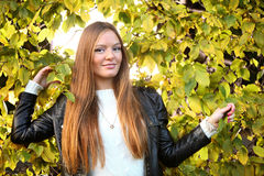 Woman girl portret in autumn green leaf wall Royalty Free Stock Photos