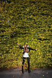 Woman girl portret in autumn green leaf wall Royalty Free Stock Photo