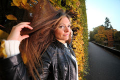 Woman girl portret in autumn green leaf wall Stock Photo