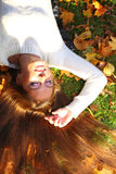 Woman girl portret in autumn leaf Stock Photos