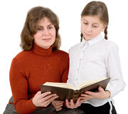 Woman and girl reads the book Stock Image