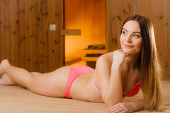 Woman girl relaxing in spa sauna. Wellbeing. Royalty Free Stock Images
