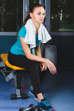 Woman girl resting at the gym On The Bench Royalty Free Stock Images