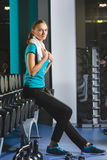 Woman girl resting at the gym On The Bench Royalty Free Stock Photos
