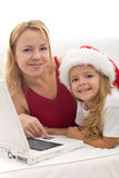 Woman and girl searching for christmas present Royalty Free Stock Photography