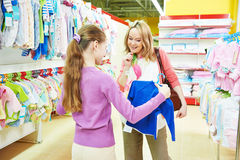 Woman and girl shopping clothes Royalty Free Stock Image