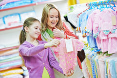 Woman and girl shopping clothes Stock Images