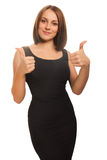 Woman girl shows positive studio sign thumbs yes, Royalty Free Stock Image