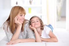 Woman and a girl smiling Royalty Free Stock Images