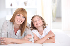 Woman and a girl smiling. Portrait of a woman and a girl smiling Royalty Free Stock Photo